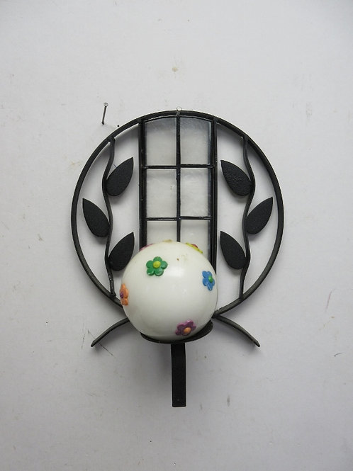 Black metal round wall hanging with leave design-holds a round candle