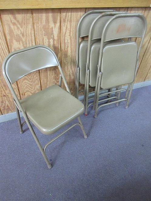 Set of 4 tan metal folding chairs, wear