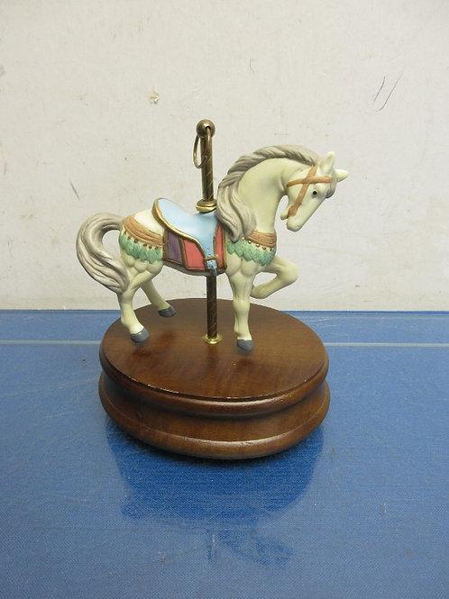 Carousel musical horse statue