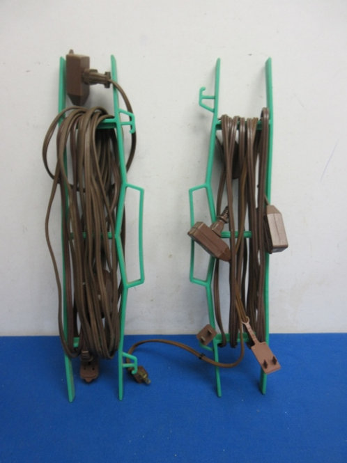 Pair of long light duty extension cords on winder