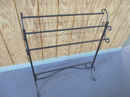 """Brown metal quilt rack with scroll design ends, 11x31x36""""high"""