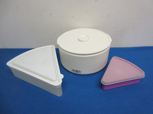 Three plastic containers w/ lids, 1 pie container, 1 pizza slice container and o