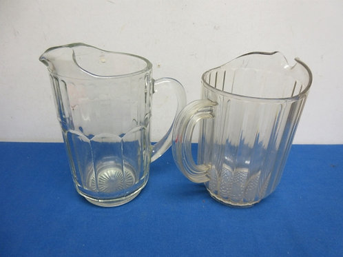 Pair of beer pitchers, one plastic, one glass