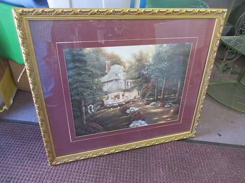 Print of a cottage with wrap around porch at dusk, gold frame 30x35