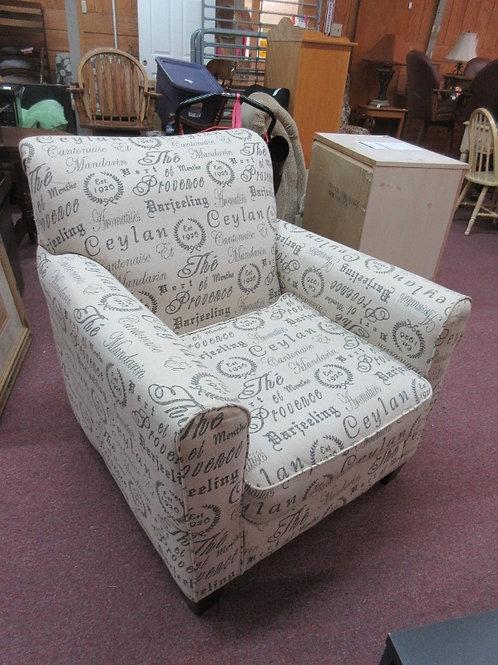Ashley Furniture Alenva tan upholstered club chair -word print