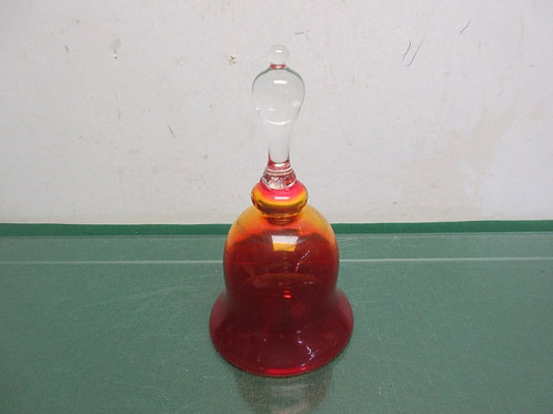 Red glass ringing bell with clear glass handle