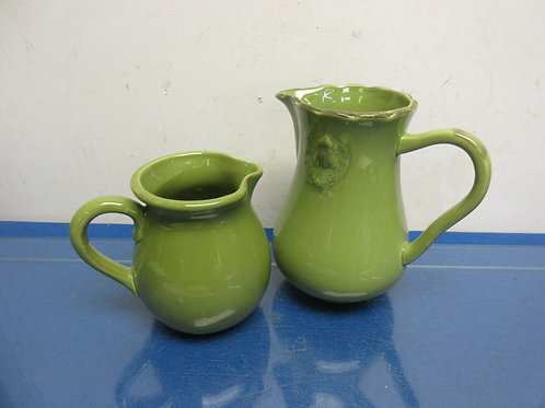 Pair of green ceramic pitchers - (1) med and (1) large