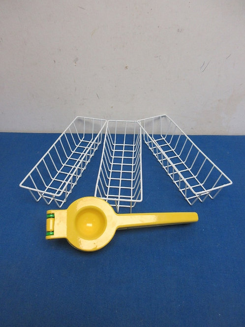 Yellow and green metal lemon squeezer and 3 small drawer organizing bins