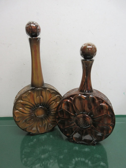 """Two Brown & black metal decanters with stoppers 14"""", 16"""" tall"""