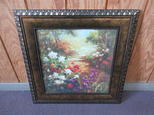 Colorful print of flowers lining a walkway in the woods, wide copper frame 25x26