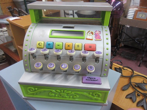 Toy cash register that does math, drawer opens, some coins