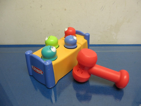 Playskool whack-a-mole toy with red hammer