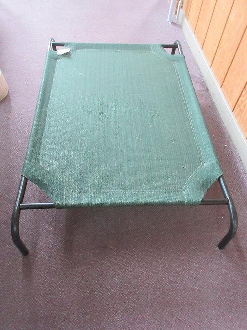 Green mesh raised dog bed, 30x45, wear