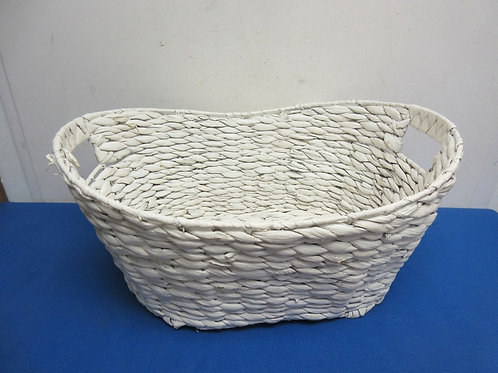 White woven oval basket with handles
