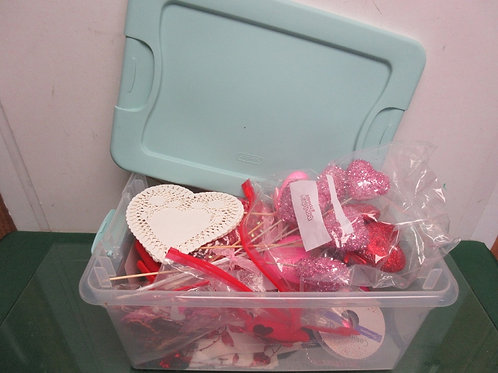 Sterilite bin with mint green snap on lid filled with assorted valentine decorat