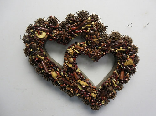 Double heart wall hanging covered with laquered nuts and beans