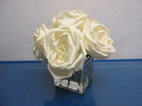 Clear glass square vase with white roses