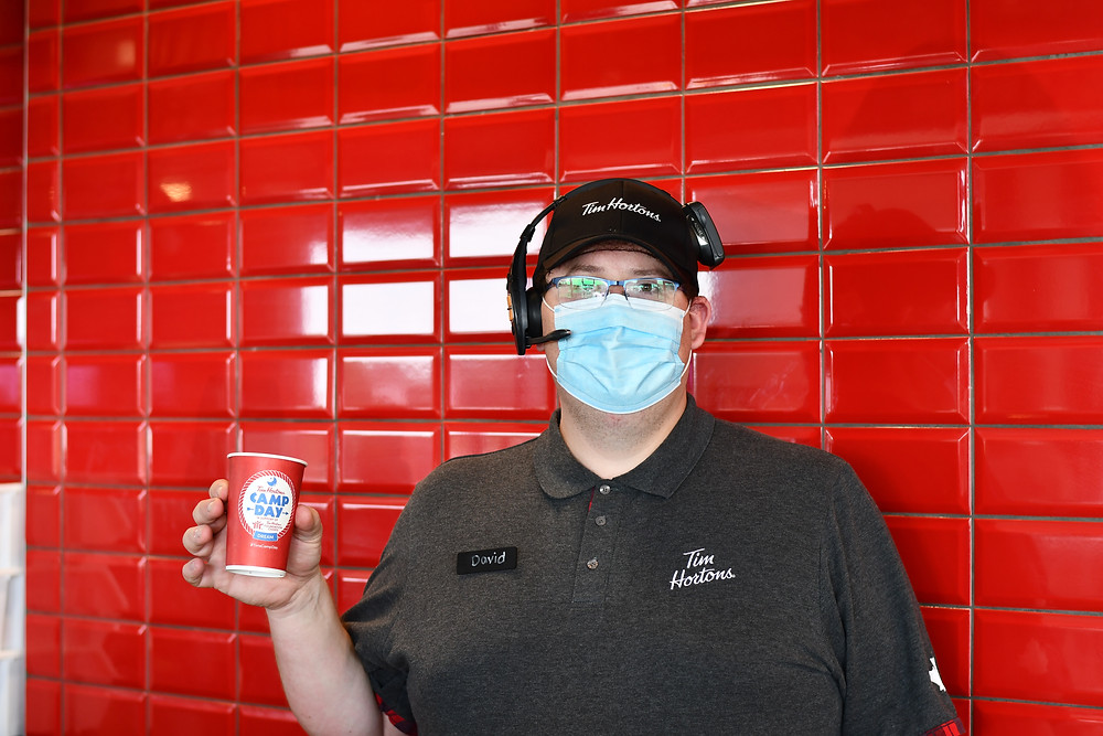 Tim Hortons employee David Rein holding a Camp Day coffee cup. Photo Elaina John