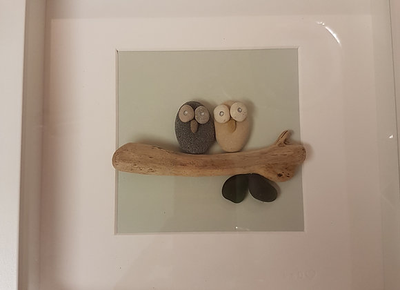 Owls on driftwood pebble art