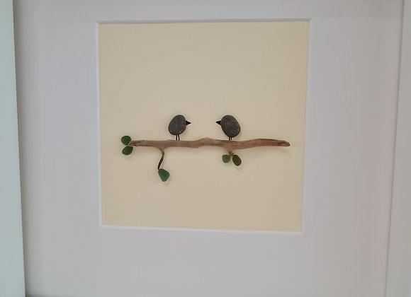 2 birds on a branch