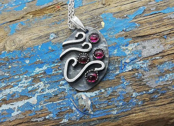 Waves and pebbles pendant