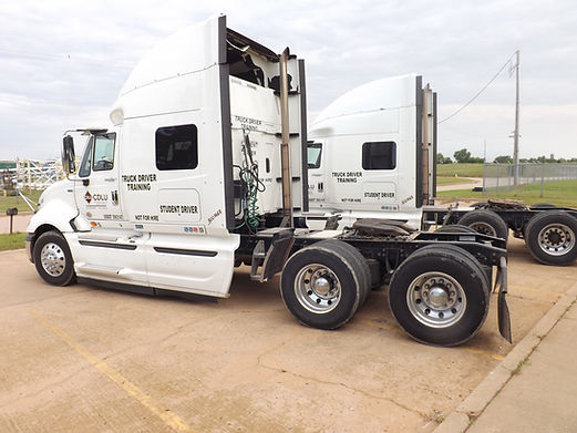 two semis at truck driving school in oklahoma