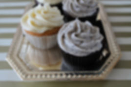 Cookies and Cream Cupcake and Vanilla Cupcake on a Gold Tray
