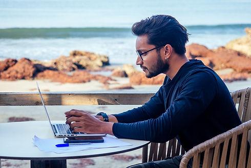 man working on beach.jpeg