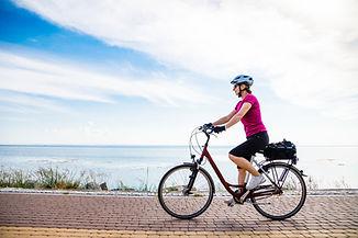 woman on bike along the coast.jpeg