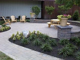 Paver patio with landscaping and patio furniture
