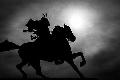 Black and white silhouette of a samurai