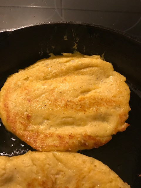 pumpkin potato pancakes sizzling in cast iron skillet