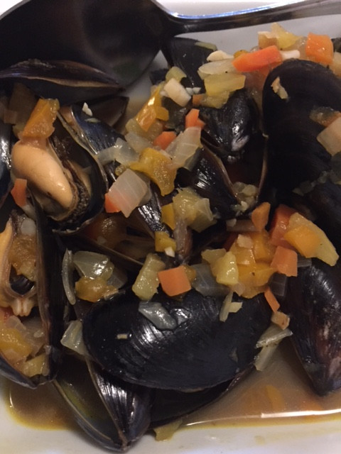 mussels in fresh ginger coconut water with pineapple