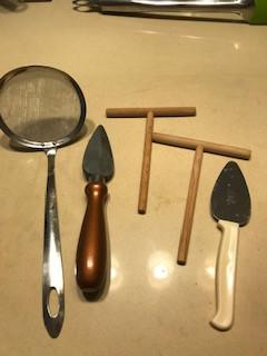 Crepe spreaders, fat skimmer, knife sharpener
