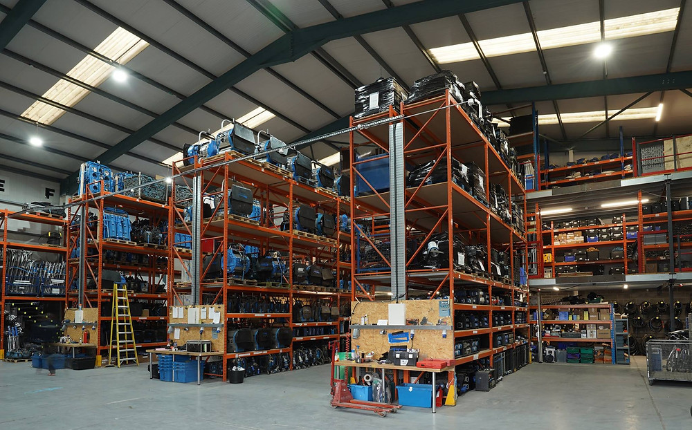 Shelving holding lighting equipment in a warehouse
