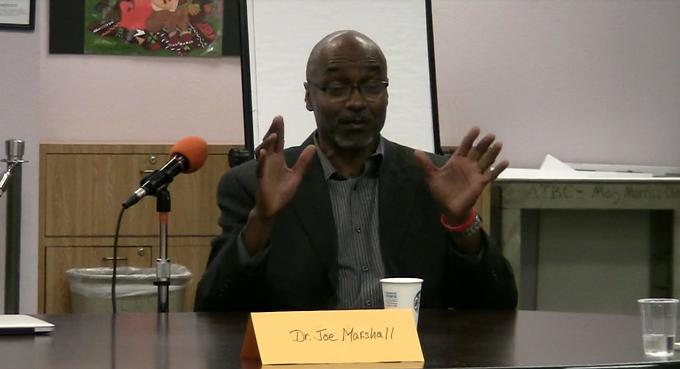 Dr. Joseph E. Marshall, Jr. talks at a town hall meeting at the Allen Temple Baptist Church