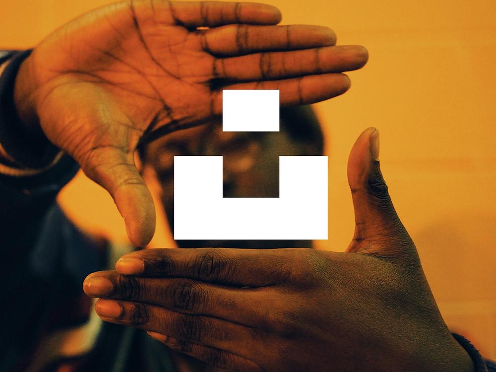 Logo Unsplash thiết kế bởi Mackey Saturday - Blitz Creatives