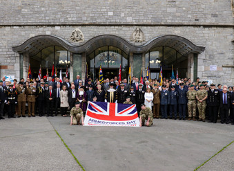 Flag raising ceremony marks start of Armed Forces Week in Plymouth