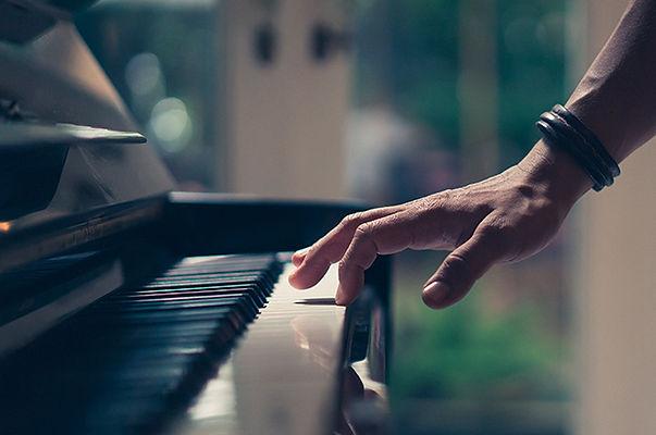 stock-photo-hand-on-piano-key-700536907-