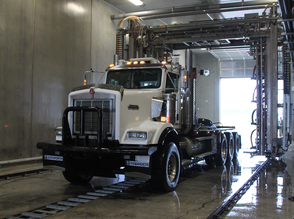Truck washed with automated wash system