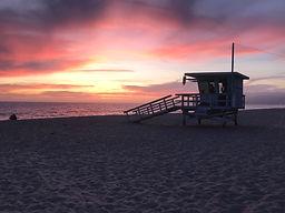 Beach vacation planner, sunset on beach, lifegaurd stand