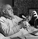 Henri_Matisse_working_on_paper_cut_out.j