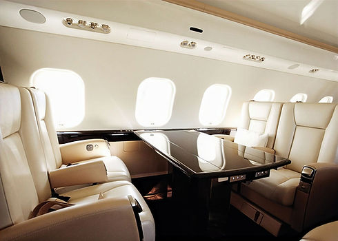 vistajet-global-6000-private-jet-table-seating_edited.jpg