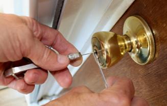 Locksmith unlocking a door lock