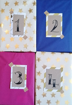4 wrapped books numbers 1,2,3,4. 2020's Indie Book Advent Calendar
