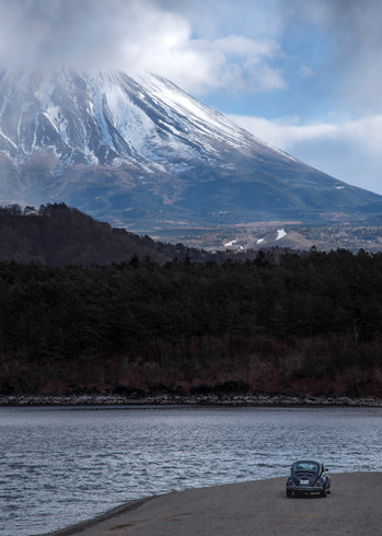 Beetle car beneath Mt Fuji
