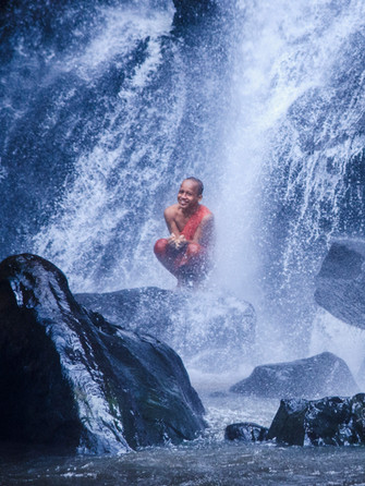 Monk in the waterfall
