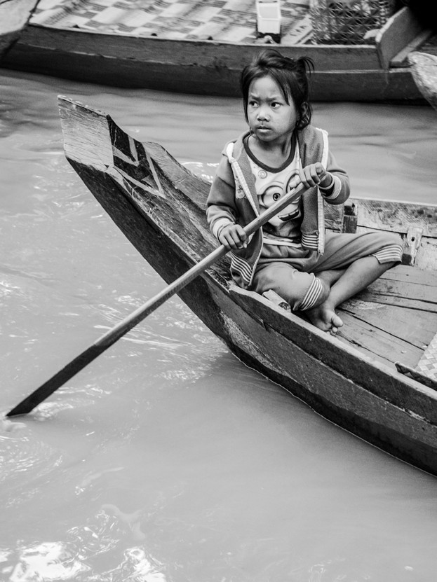 Young girl working on local boats.