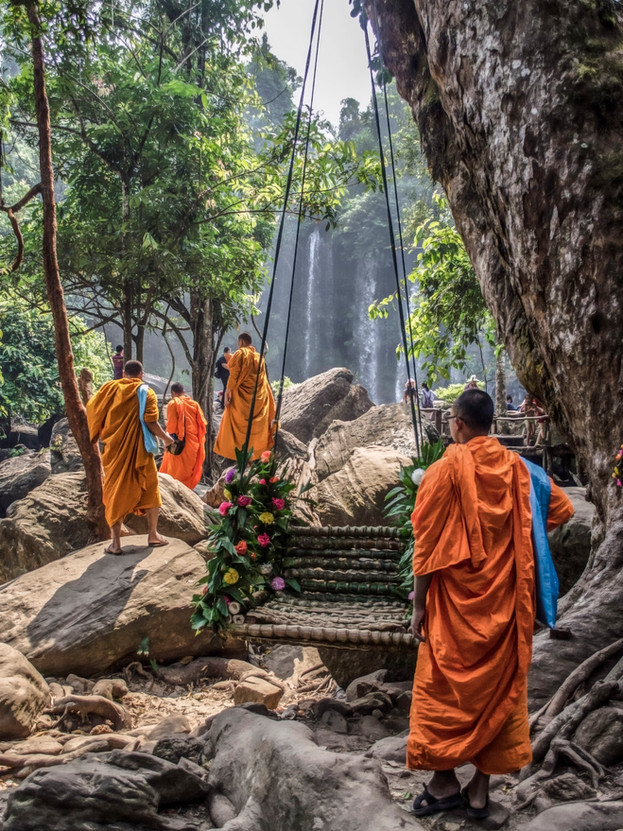 Monks arriving to swim.