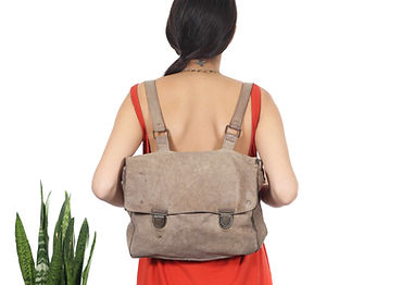 Woman wearing backpack from back